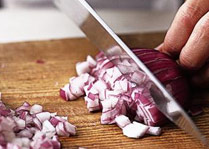 Red onion being diced