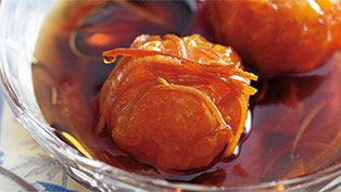 Poached caramel clementines