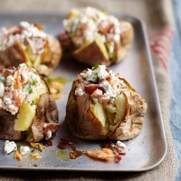 Speedy jacket potatoes with crispy bacon and salmon